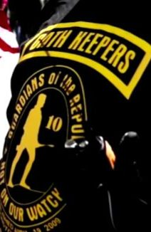 racist cop wearing Oath Keepers patch on his shoulder